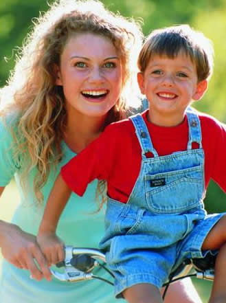 young mom and son on bike image